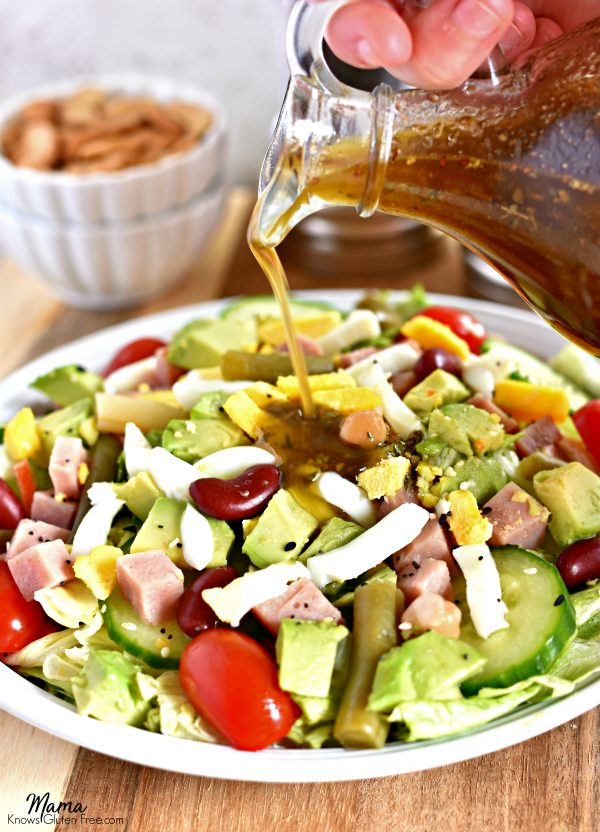 Balsamic Vinaigrette Salad Dressing being poured on top of a salad