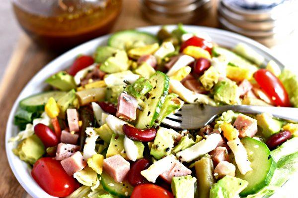 A salad with homemade balsamic vinaigrette salad dressing on top