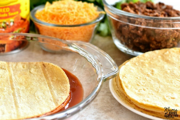 corn tortillas ,Old El Paso mild red enchilada sauce, cheddar cheese and taco meat