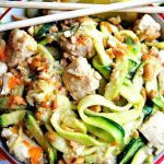 honey lemon ginger chicken zoodles in a bowl with lemon slices and chopsticks