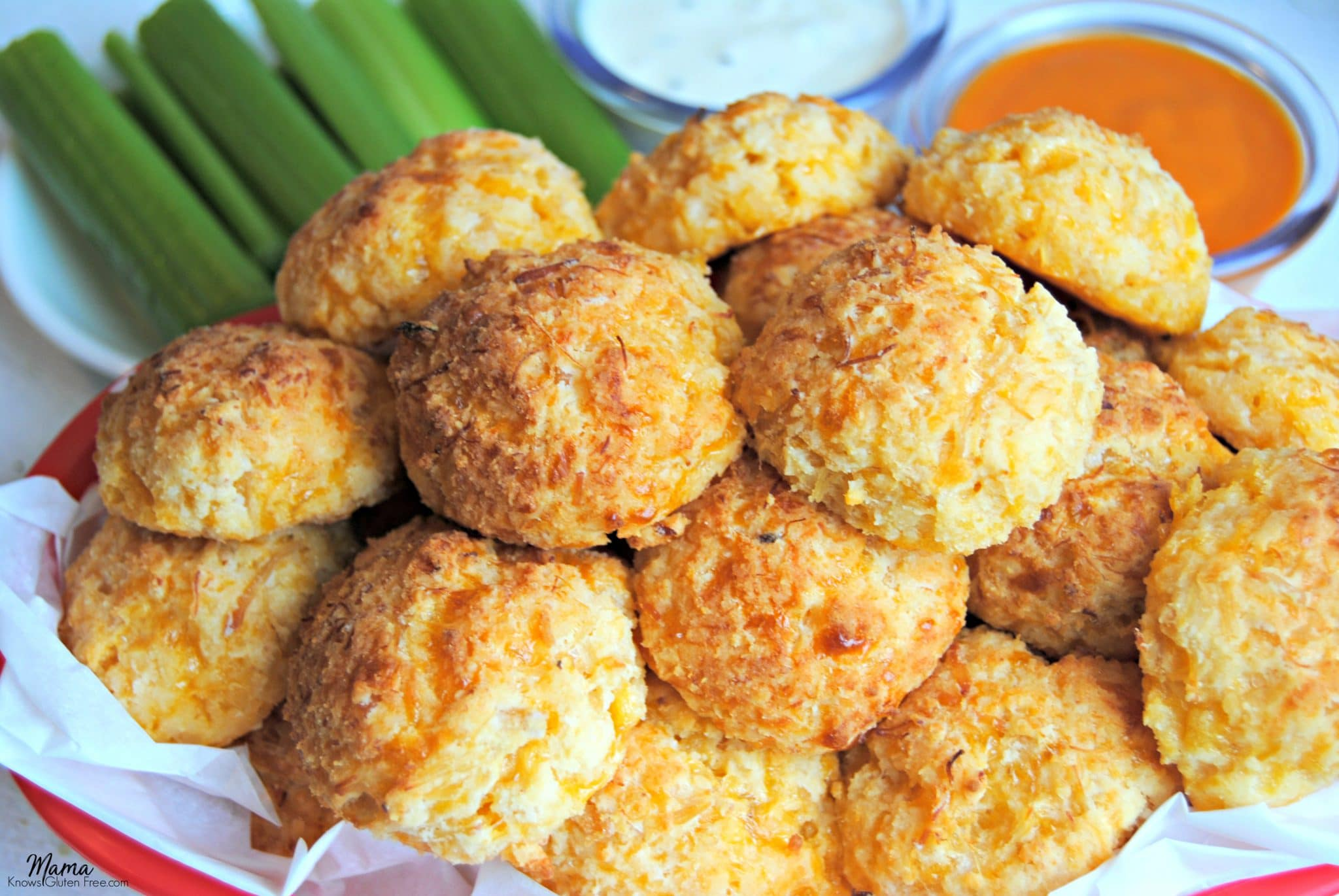 gluten-free buffalo chicken bites in a basket with celery and sauce