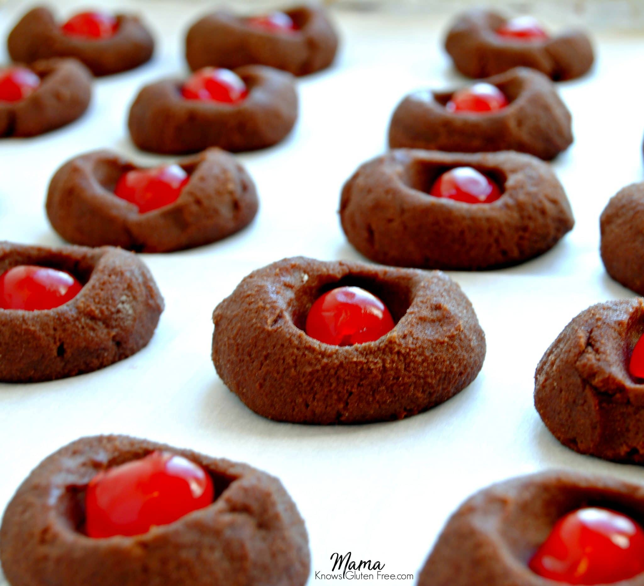 Gluten-Free Chocolate Thumbprint Cookies batter with cherries in them