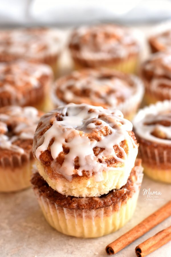 cinnamon roll muffins batch with cinnamon sticks