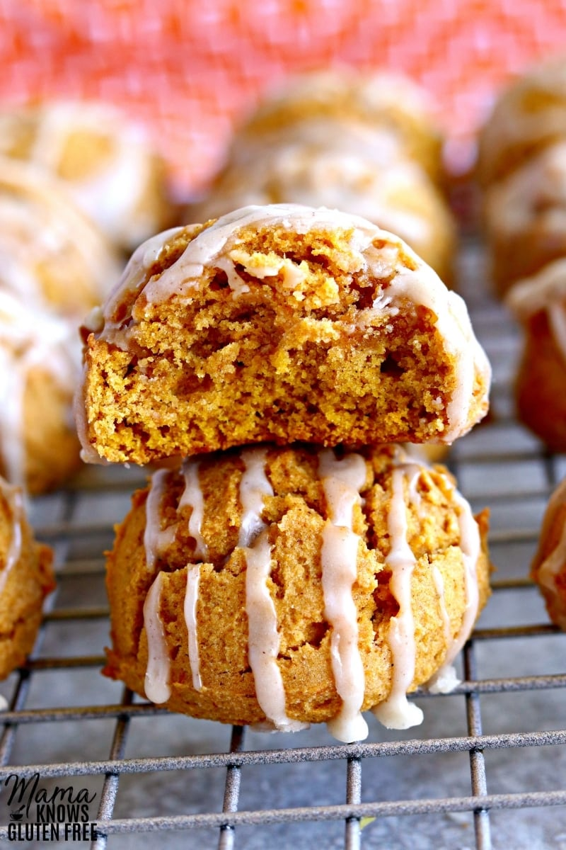 gluten-free pumpkin cookies stacked on top of each other on a cooling rack