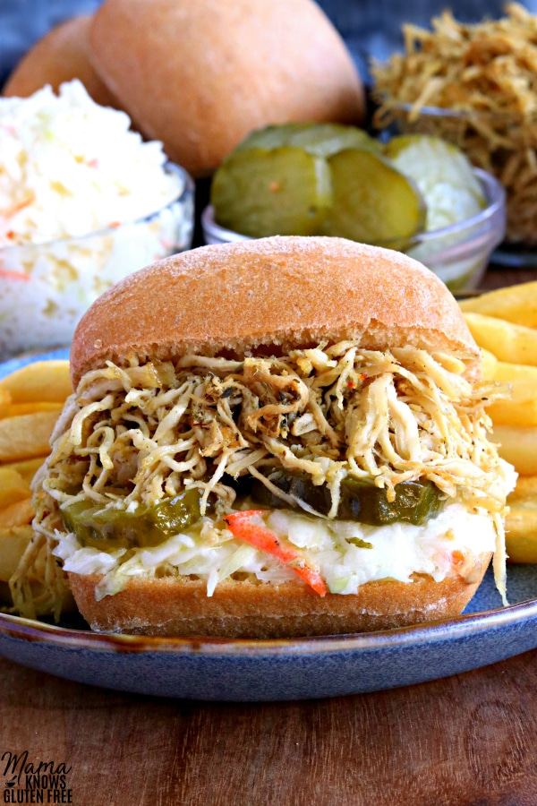 Shredded Chicken Sandwich with Coleslaw and Pickles on Ciabatta Bread with French Fries