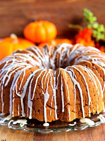 gluten-free pumpkin bundt cake with pumpkins in the background