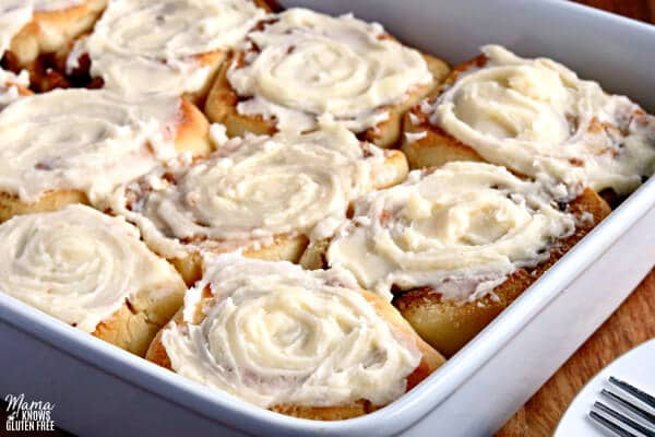 a pan of gluten-free cinnamon rolls with frosting