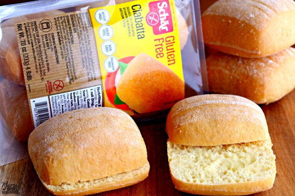 4 gluten-free Ciabatta rolls and a package of rolls in the background