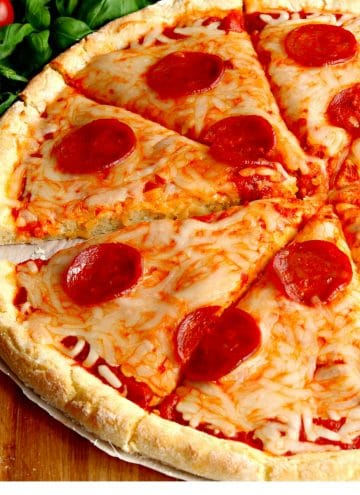 gluten-free pizza topped with cheese and pepperoni
