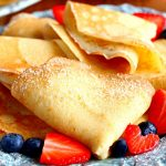 folded gluten-free crepes with strawberries and blueberries