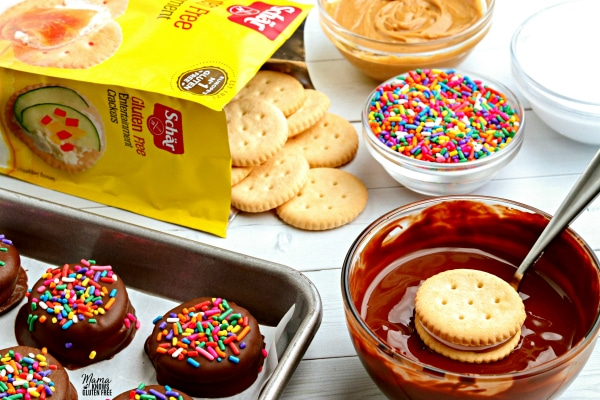 gluten-free no-bake-cracker cookies recipe step dipping cookies in melted chocolate