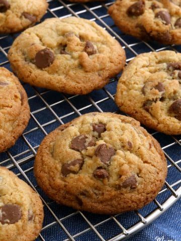 gluten-free chocolate chip cookies on a sliver cooling rack