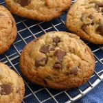 gluten-free chocalte chip cookies on cooling rack with blue kitchen towel