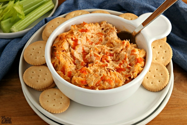 bowl of buffalo chicken dip with a spoon and crackers