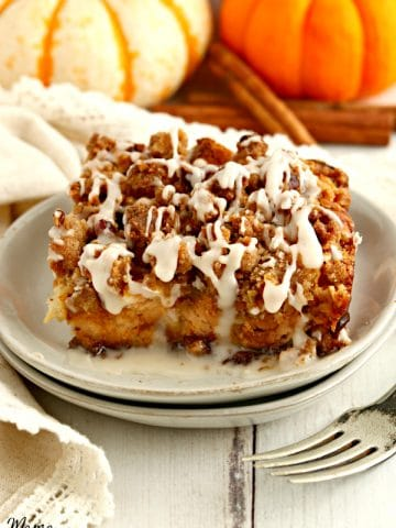 a serving of gluten-free pumpkin French toast casserole on a white plate with a fork