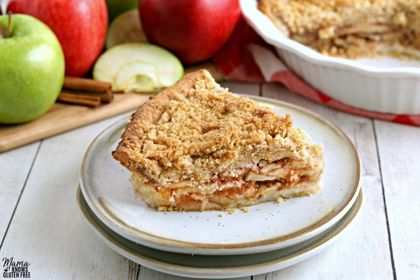 gluten-free apple pie with apples and the pie in the background