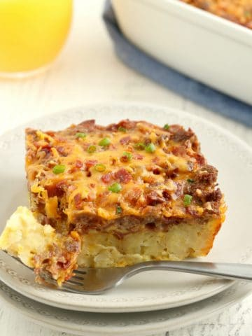 piece of gluten-free breakfast casserole on a plate with a fork