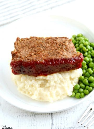 slice of gluten-free meatloaf with mashed potatoes and green peas