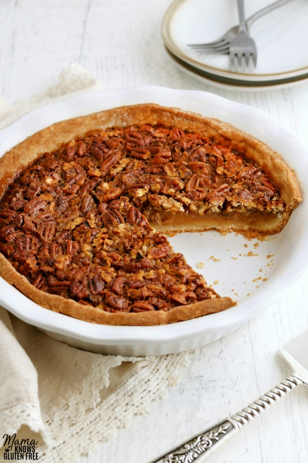 gluten-free pecan pie with a slice cut out of it