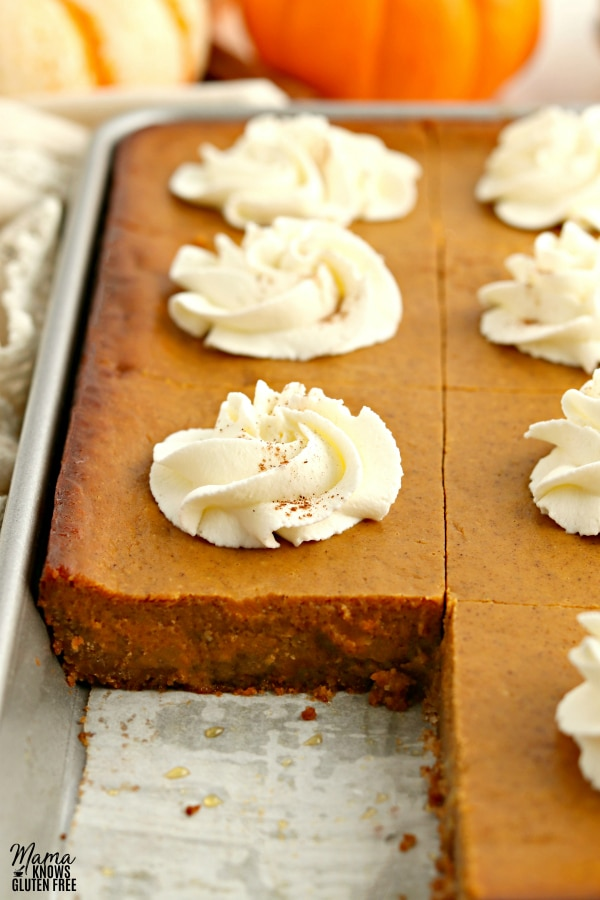 pan of gluten-free pumpkin pie bars with a serving cut out