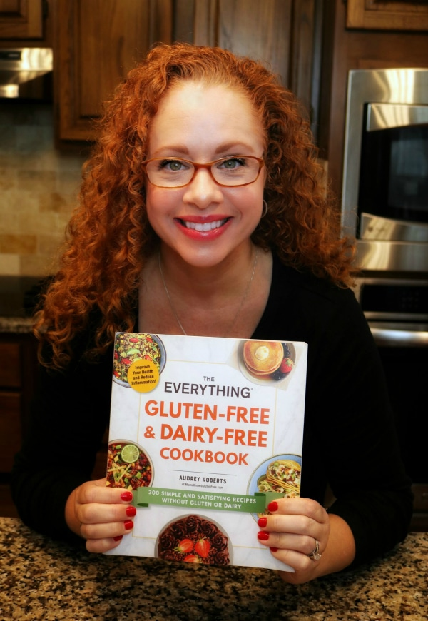 Audrey Roberts holding her cookbook The Everything Gluten-Free & Dairy-free Cookbook