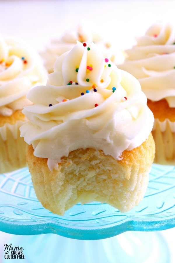 gluten-free vanilla cupcake with bit out of it to show the texture