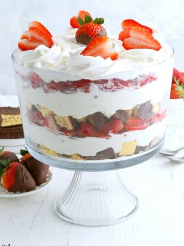 Gluten-Free Chocolate Strawberry Cheesecake Trifle with strawberries in the bakcground