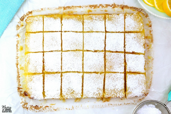 gluten-free lemon bars cut into 24 squares and topped with powdered sugar