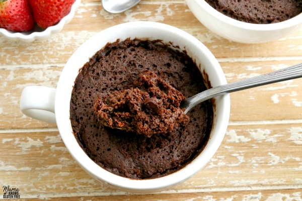 gluten-free chocolate mug cake with strawberries and another cake in the background