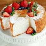 gluten-free angel food cake topped with strawberries and blueberries