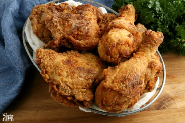 basket of gluten-free fried chicken with parsley in the background