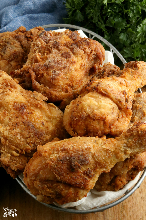 gluten-free fried chicken in a basket with parsley in the background
