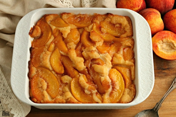 gluten-free peach cobbler in a white baking dish