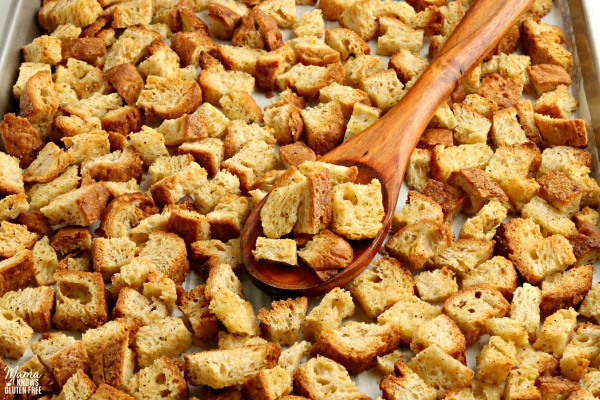 gluten-free croutons with a wooden spoon