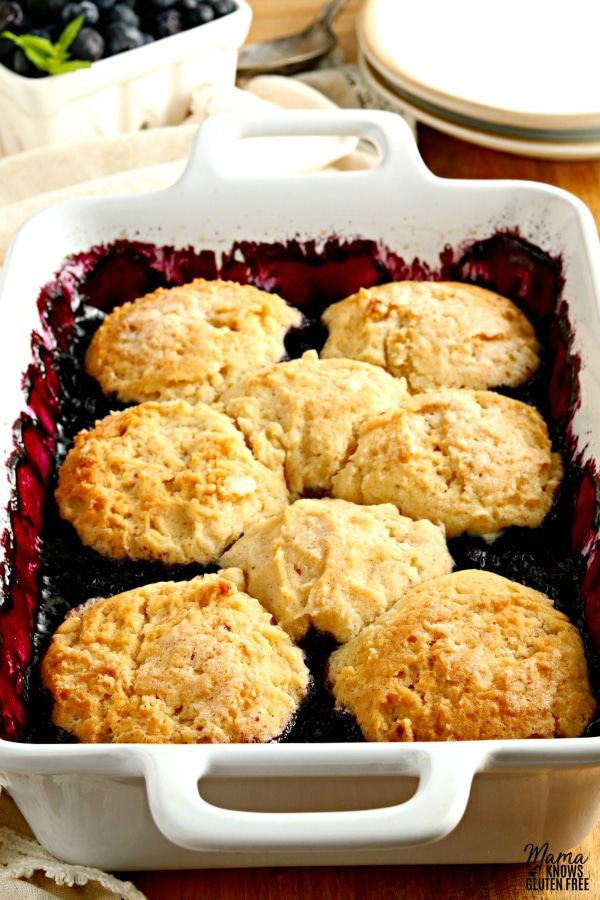 white baking dish of gluten-free blueberry cobbler