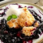 gluten-free blueberry cobbler topped with ice cream