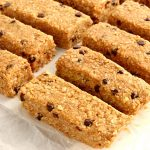 gluten-free granola bars on white parchment paper