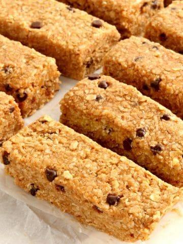gluten-free granola bars on white parchment paper