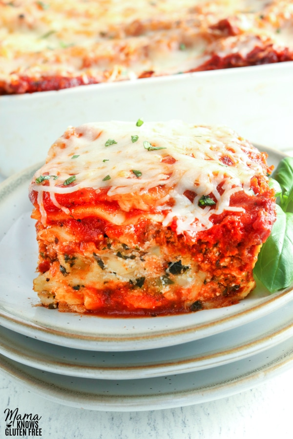 gluten-free lasagna serving on a plate with the lasagna pan in the background