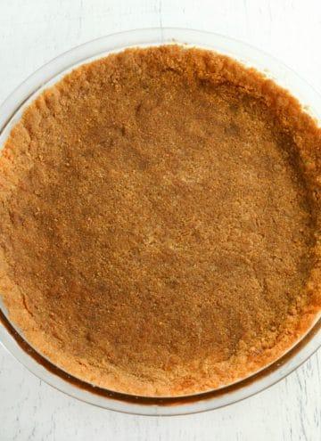 gluten-free graham cracker crust in a glass pie pan