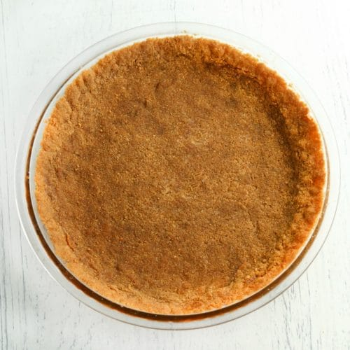 gluten-free graham cracker crust in a glass pie pan