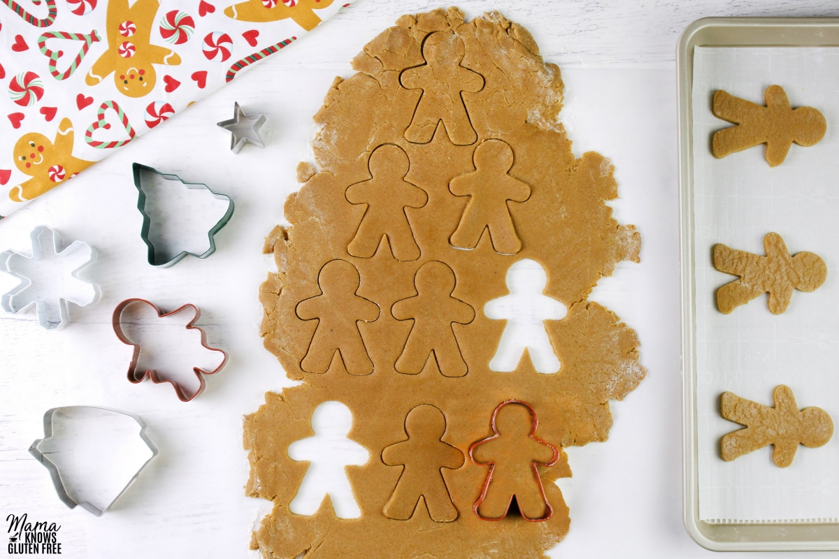 gluten-free gingerbread cookie doug being cut out into shapes
