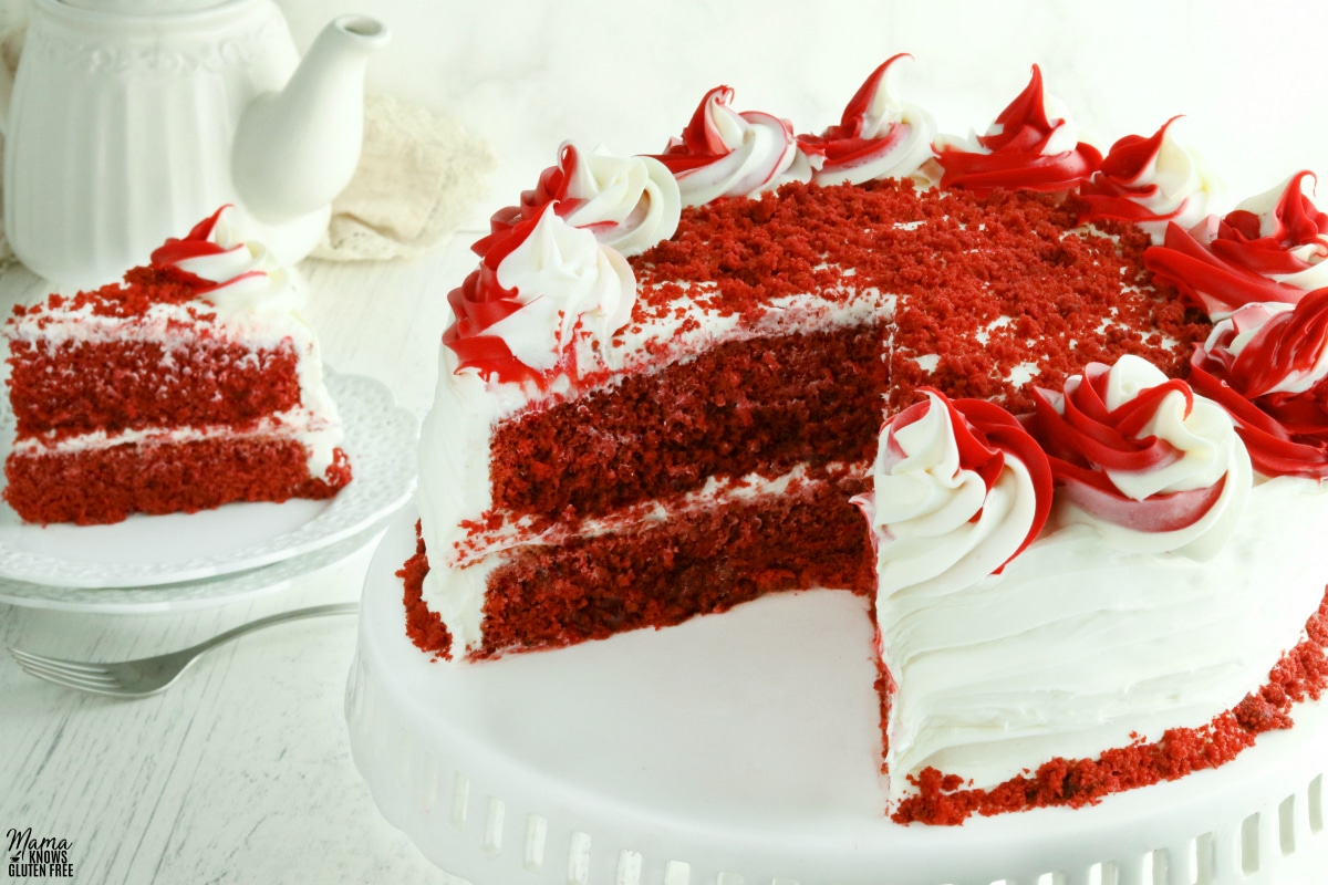gluten-free red velvet cake cut with a slice of cake in the backgorund