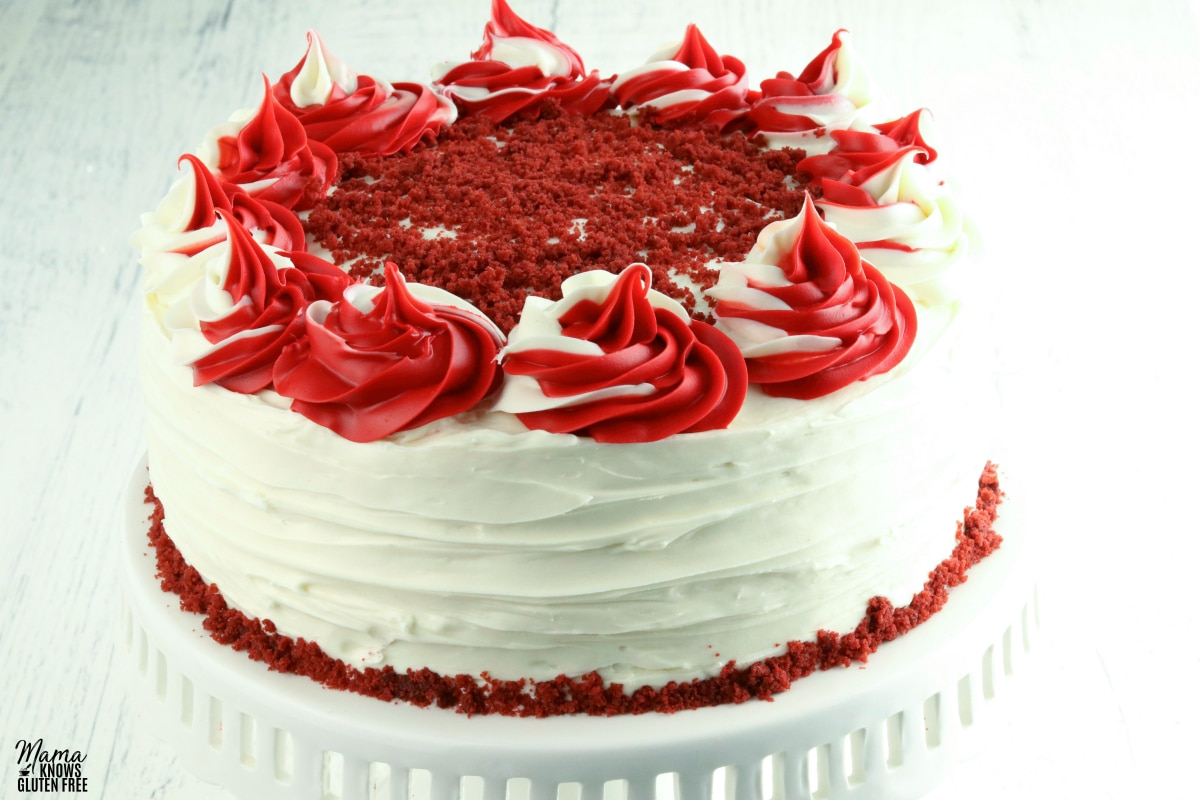 gluten-free red velvet cake on a white cake stand