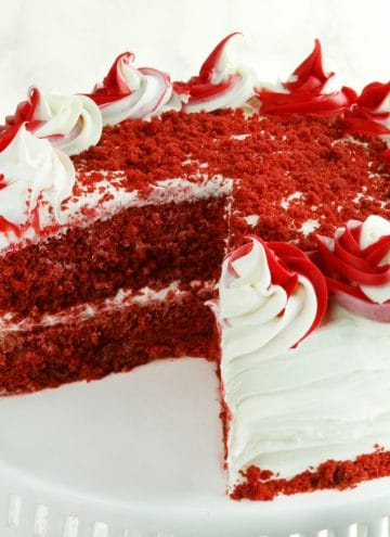 gluten-free red velvet cake with slice cut out of it