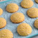 gluten-free lemon cookies on a blue cookie sheet