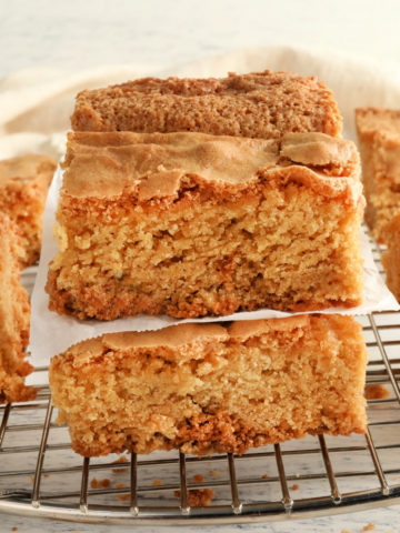 gluten-free blondies stacked on top of each other on a cooling rack