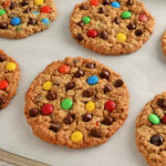 gluten-free monster cookies on white parchment paper.