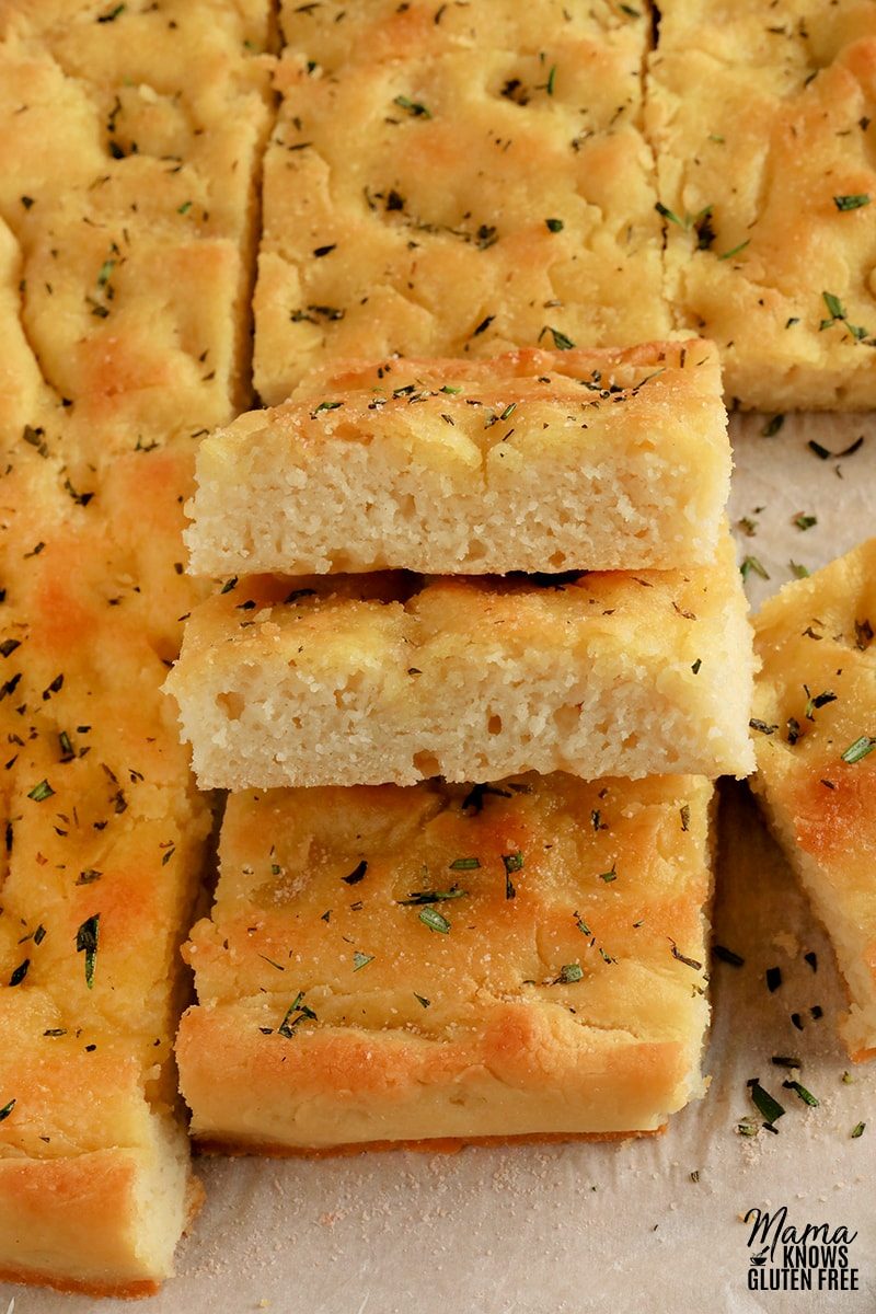 gluten-free focaccia bread slices stacked on top of each other to show the bread's texture