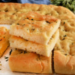 gluten-free focaccia bread sliced and stacked on top of each other